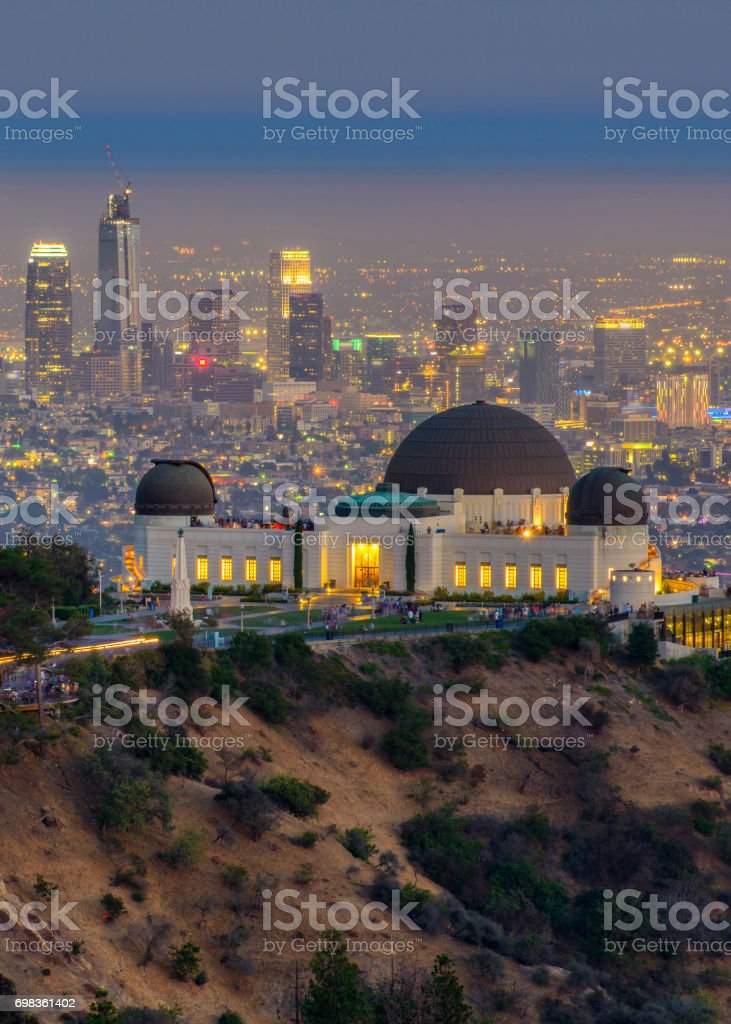 The Griffith Observatory and Los Angeles city skyline at twilight time stock photo