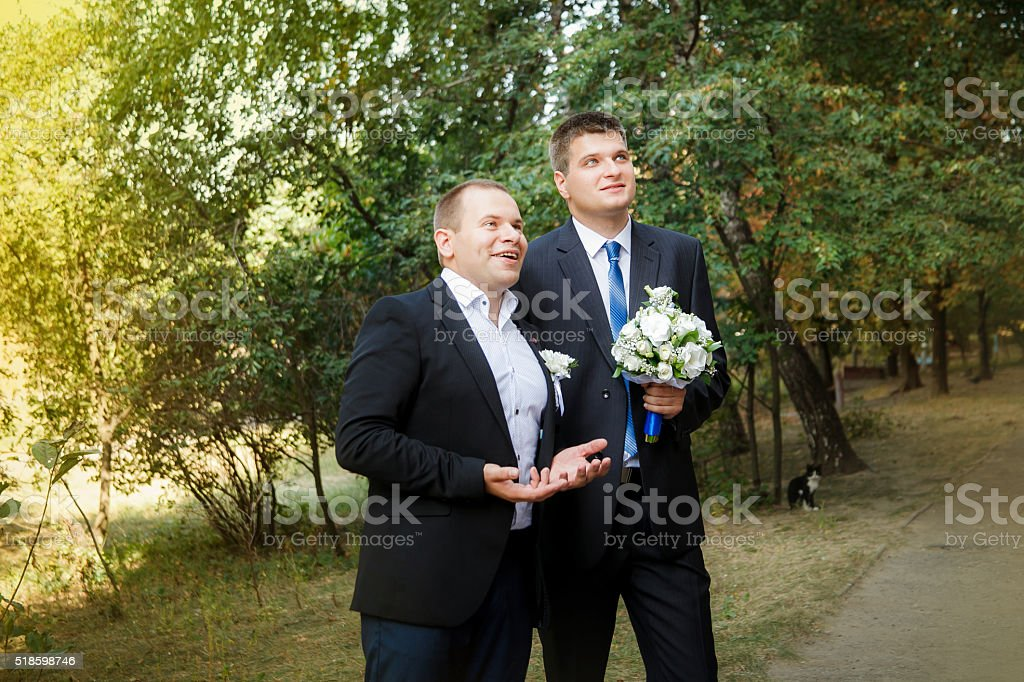 The groom and groomsman  came to the bride stock photo