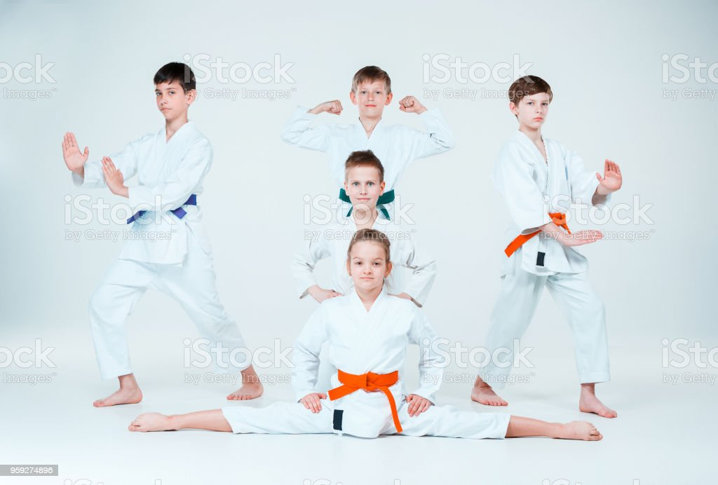 The group of boys and girl fighting at Aikido training in martial arts school. Healthy lifestyle and sports concept stock photo
