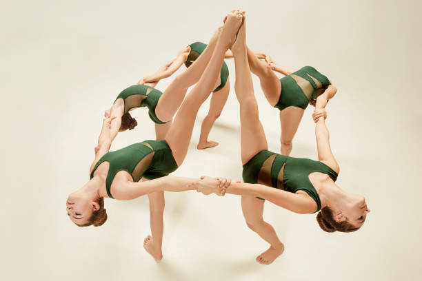 the group of modern ballet dancers - dance group stock photos and pictures