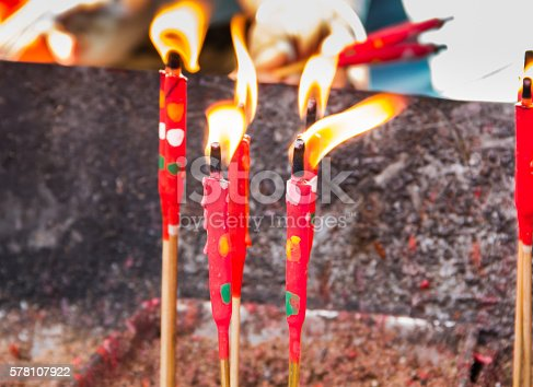 The group of red candle in matal incense base