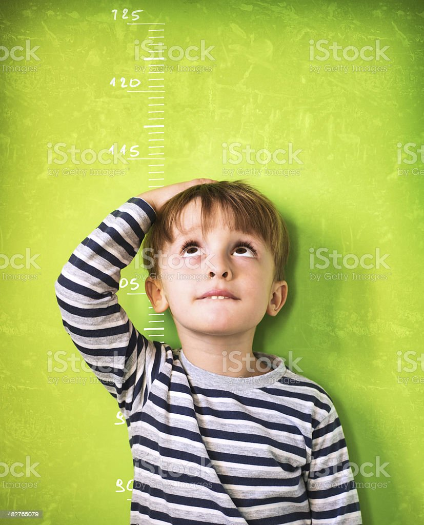 The growing child - Green Background stock photo