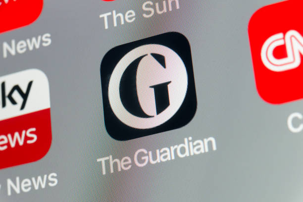 The Guardian, Sky News, CNN and other cellphone Apps on iPhone screen stock photo