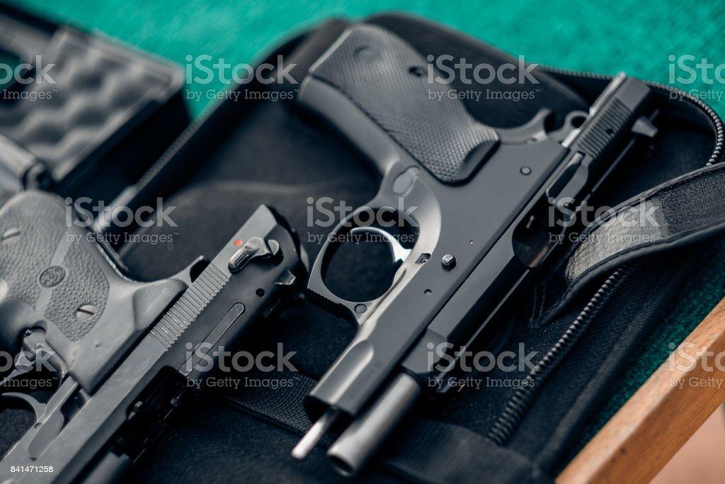 The gun and gun Short black pistol stock photo