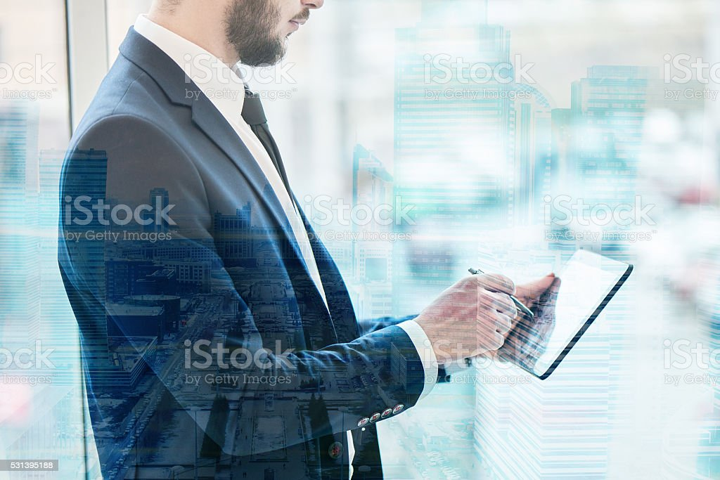 The guy businessman holding a tablet stock photo