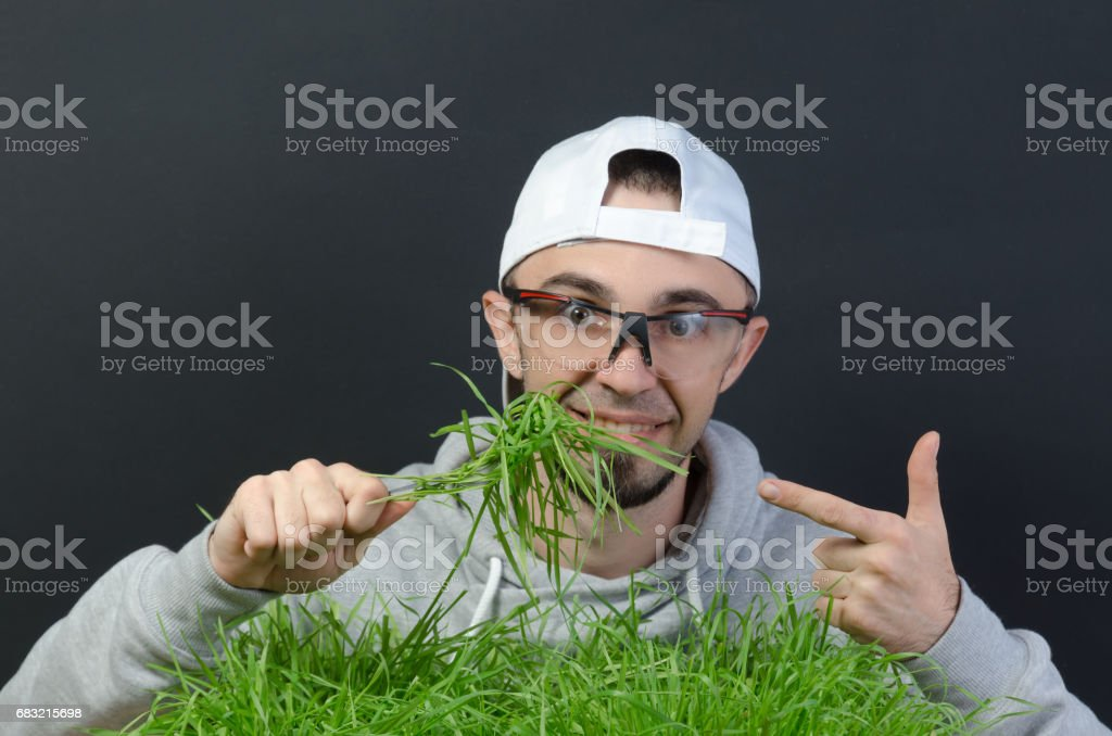 the guy eats the green grass royalty-free 스톡 사진