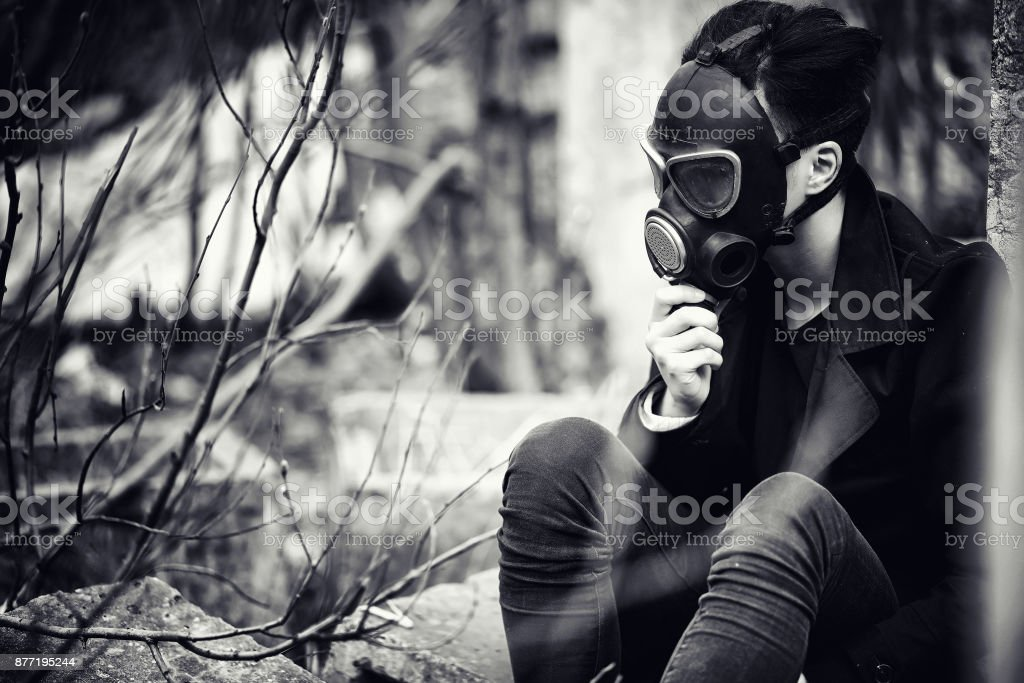 The guy in the coat and gas mask. Post-apocalyptic portrait of A stock photo