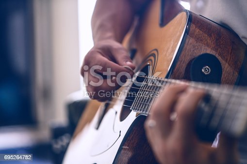 istock the guy playing the acoustic guitar 695264782