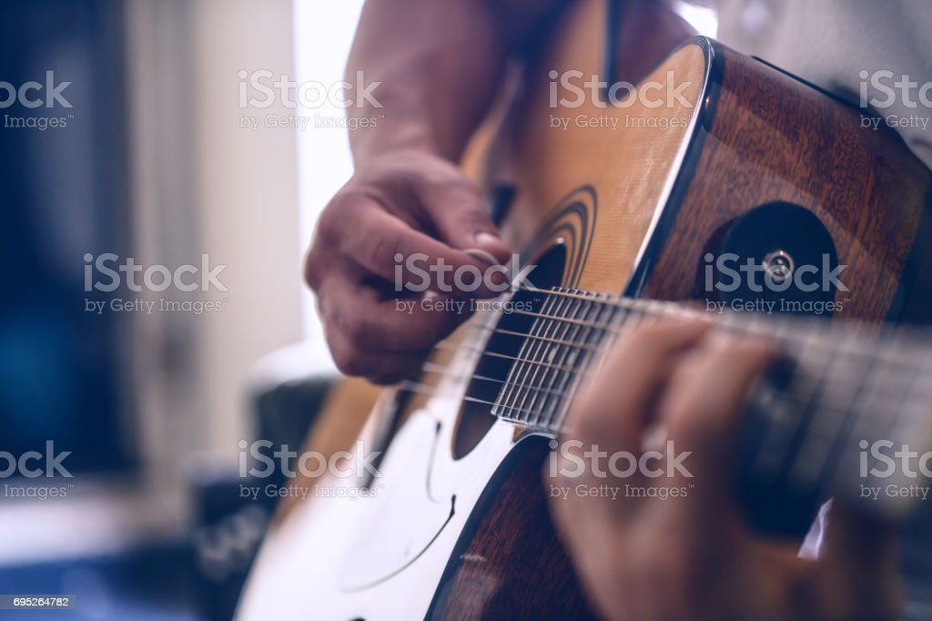 the guy playing the acoustic guitar stock photo