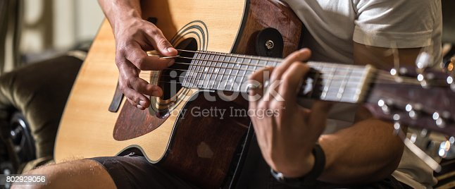 istock the guy playing the acoustic guitar 802929056