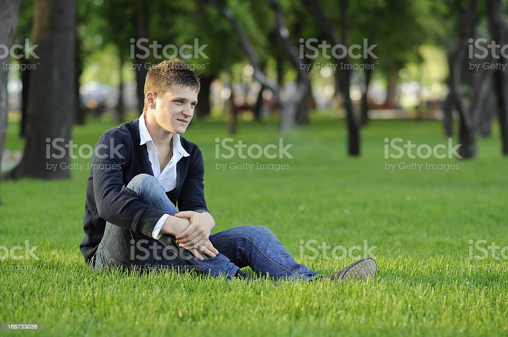 the guy sitting on grass royalty-free stock photo