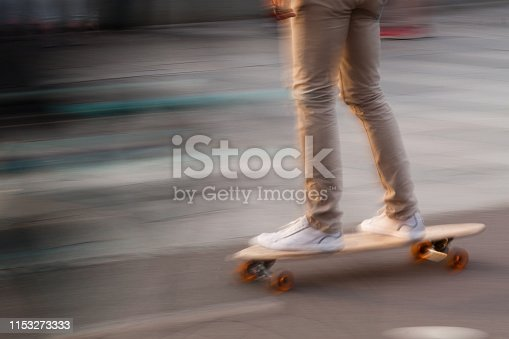 A boy skateboarding in a summer city park