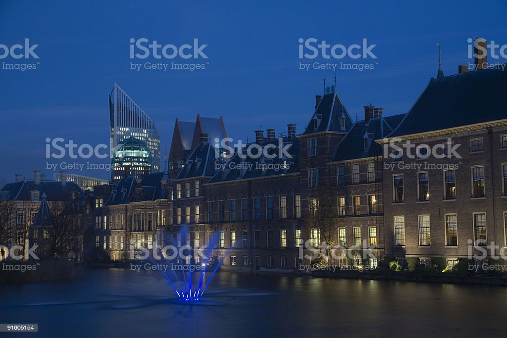 The Hague's illuminated parliament buildings just after sunset royalty-free stock photo