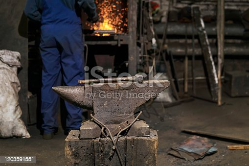 istock the hammer lies on the anvil in the forge while the blacksmith went to the furnace 1203591551