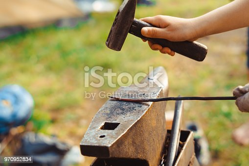 istock the hammer on the anvil 970952834