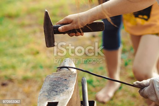 istock the hammer on the anvil 970953062