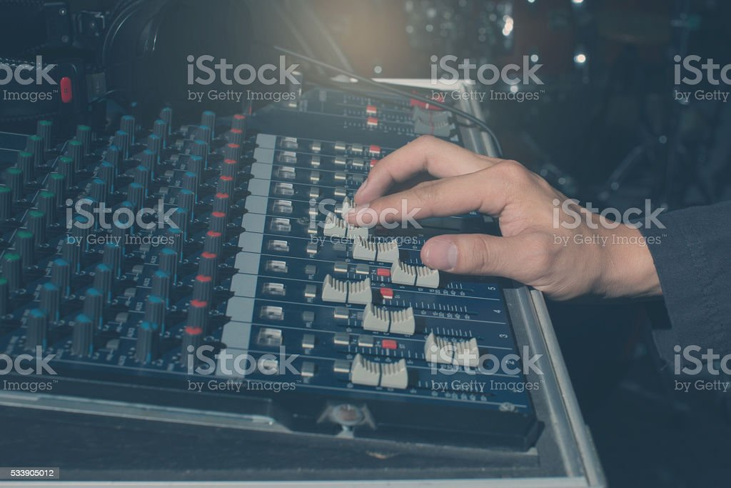 The hand adjust sound audio mixer board stock photo