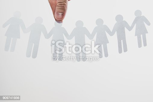istock The hand chooses a character among other people. 909741936