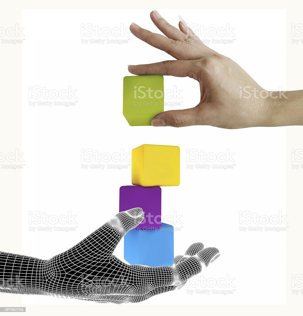 The hand establishes a toy roof on wooden cubes. royalty-free stock photo