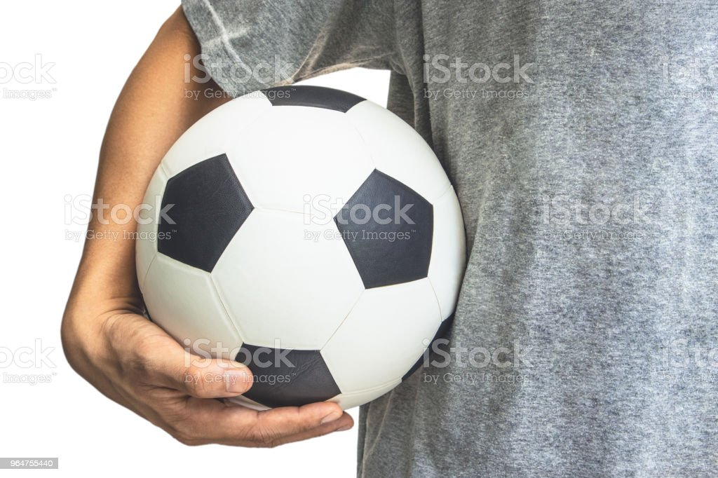 The hand holds the ball at the waist royalty-free stock photo