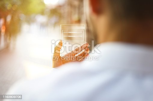 171347585 istock photo The hand of a man in suits, uses a futuristic glass phone with the latest advanced holographic technology. Concept of: future, technology, smartphone, augmented reality 1163809706