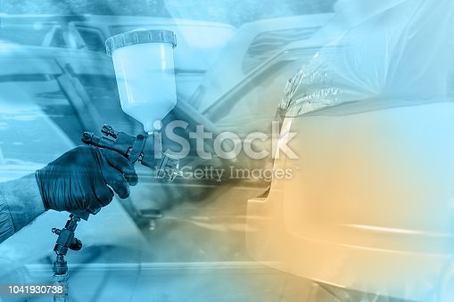 istock The hand of a man with an airbrush stains car parts on an abstract background, a double exposure, a car repair concept 1041930738