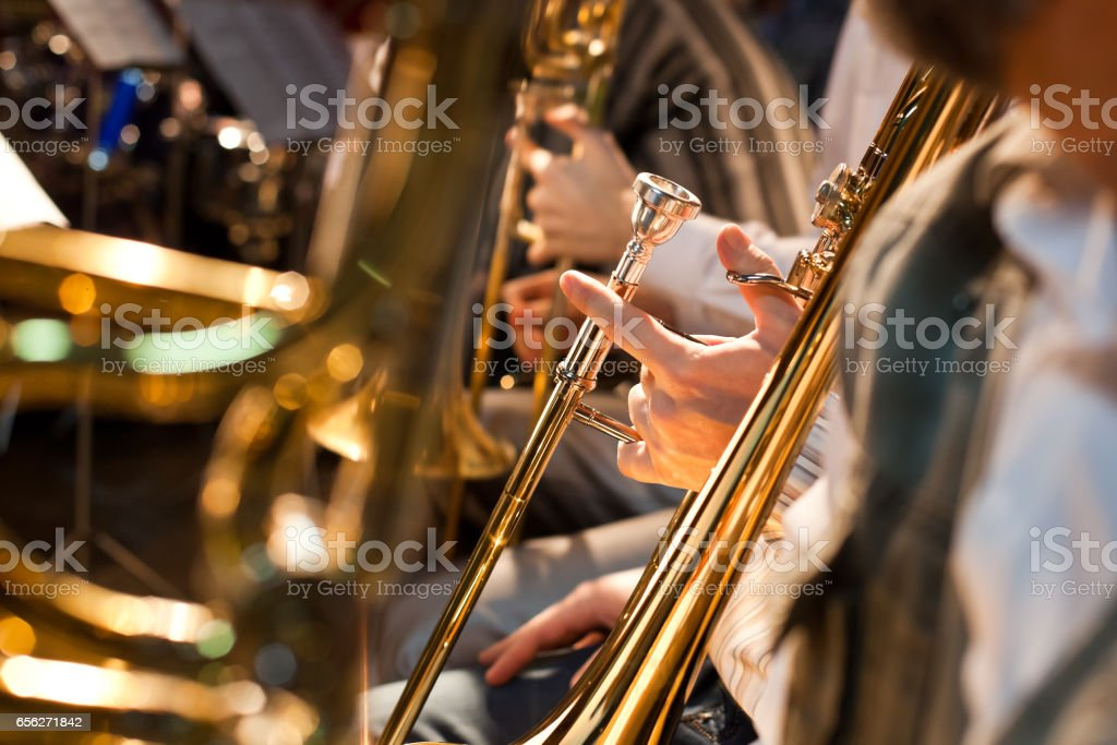 The hand of a musician holding a trombone stock photo