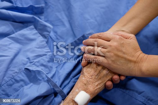 istock The hand of the woman is holding mother's hand 903973224