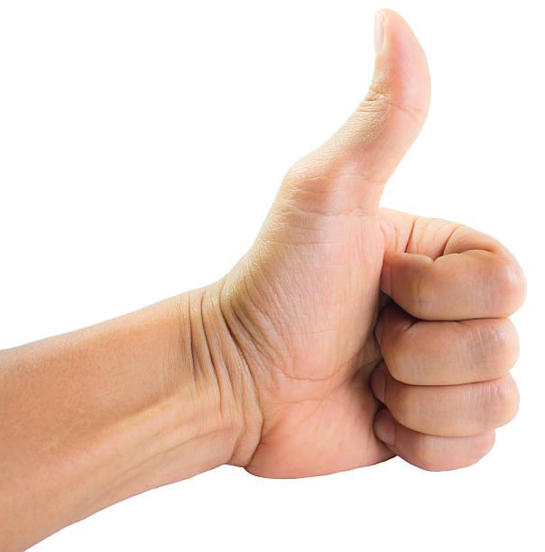 La main montre thumbs vers le haut - Photo