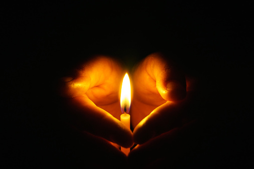 The hand that protects the candles in the dark.