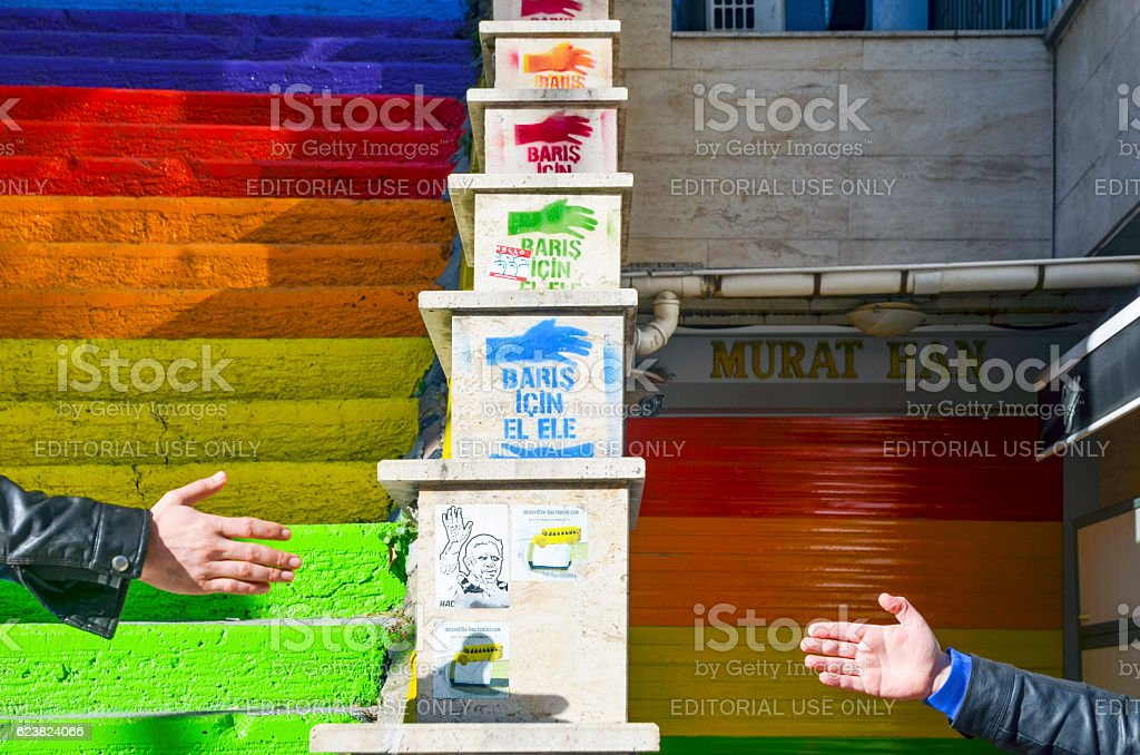 The hand writes 'Alliance for Peace' on the Image stock photo