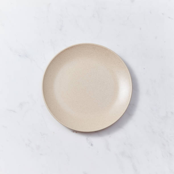 The handmade ceramic dish on a gray marble table. Traditional ceramic handcrafted. Flat lay stock photo
