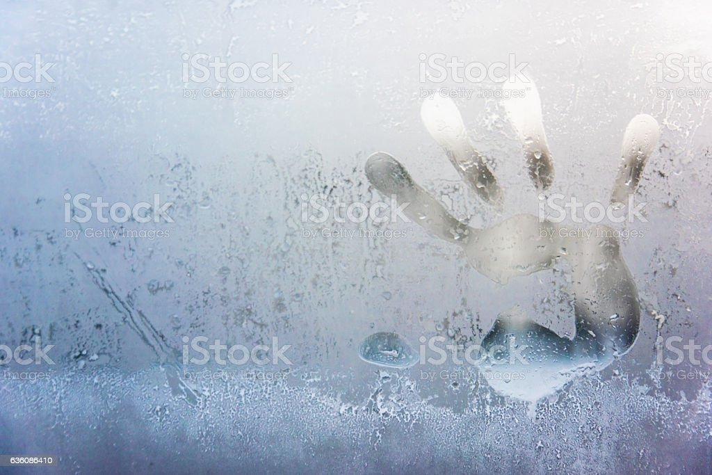 the handprint of the male palms to the frosty glass stock photo