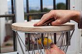 istock The hands of a carpenter sanding a stool 1292918644