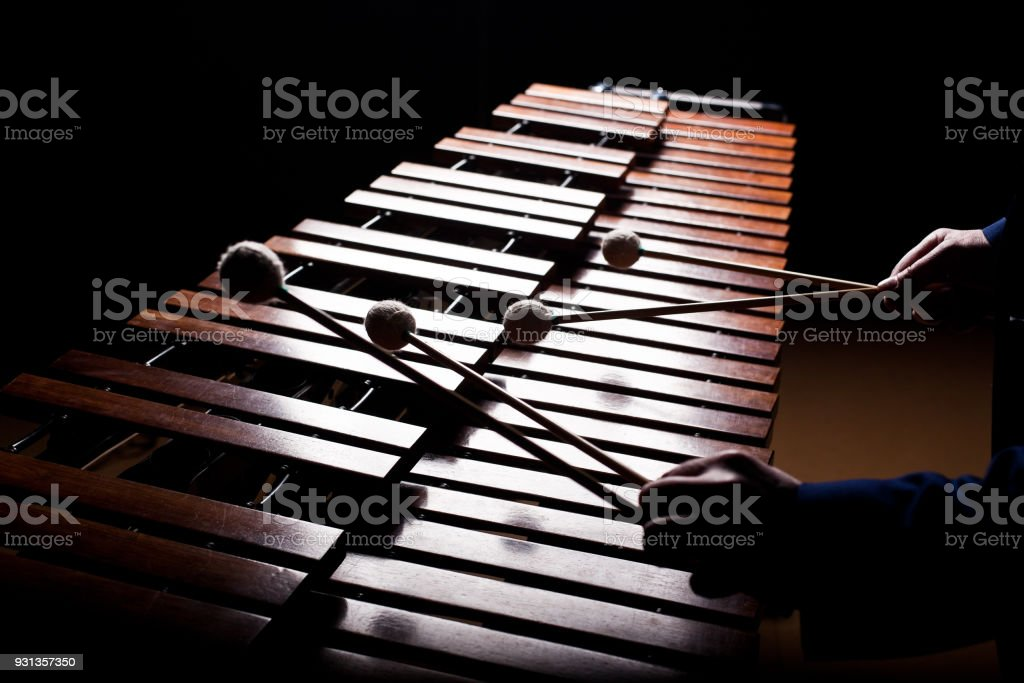 The hands of a musician playing the marimba stock photo