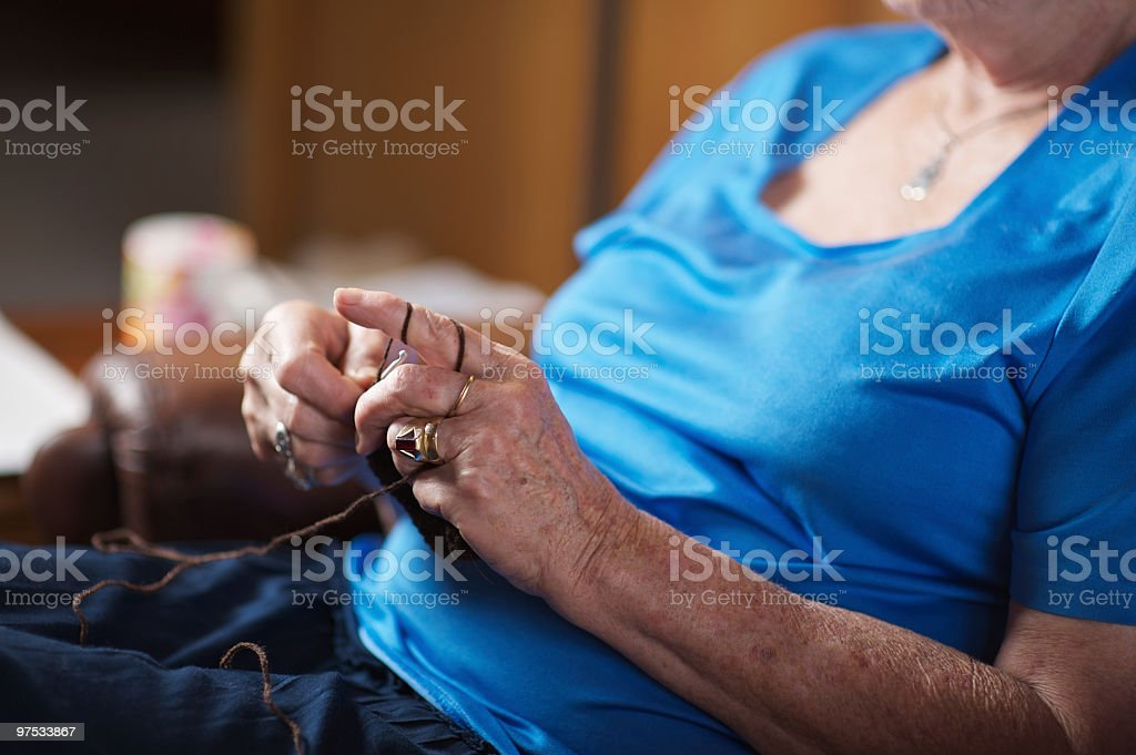 The hands of a senior woman knitting or crocheting. royalty-free stock photo