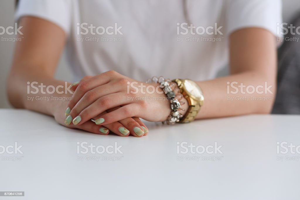 The hands of a woman on the desk of the school stock photo