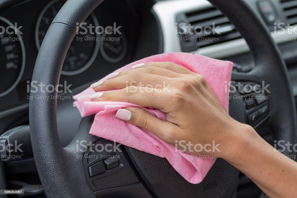 The hands of girls rubbing their car. royalty-free stock photo