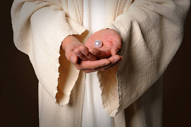 The Hands of Jesus Holding Pearl stock photo