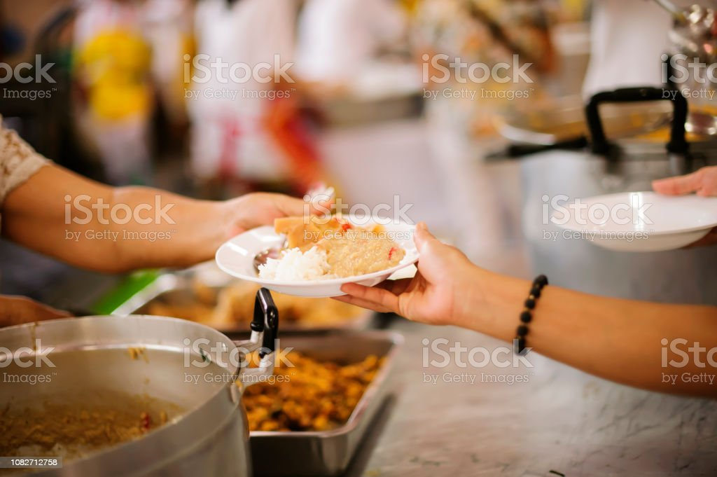 The hands of refugees have been aided by charity food to alleviate...