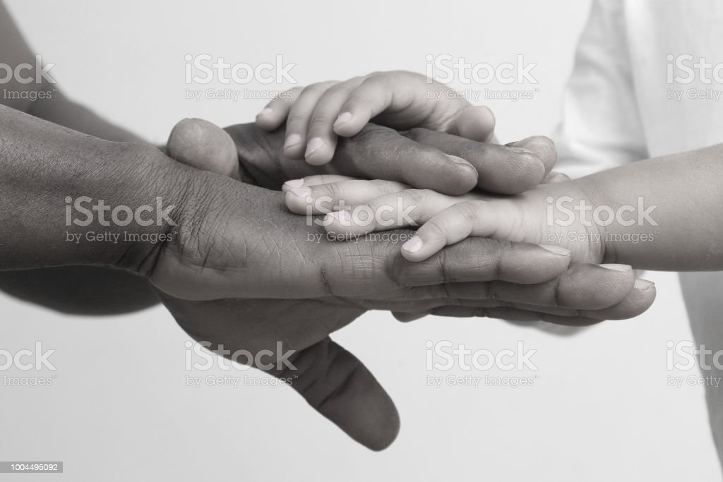 the hands of the father and child together