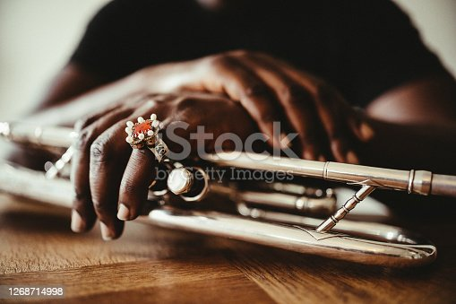 istock The hands of the trumpet player 1268714998