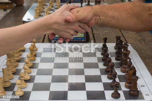 the handshake of the players before the game of chess