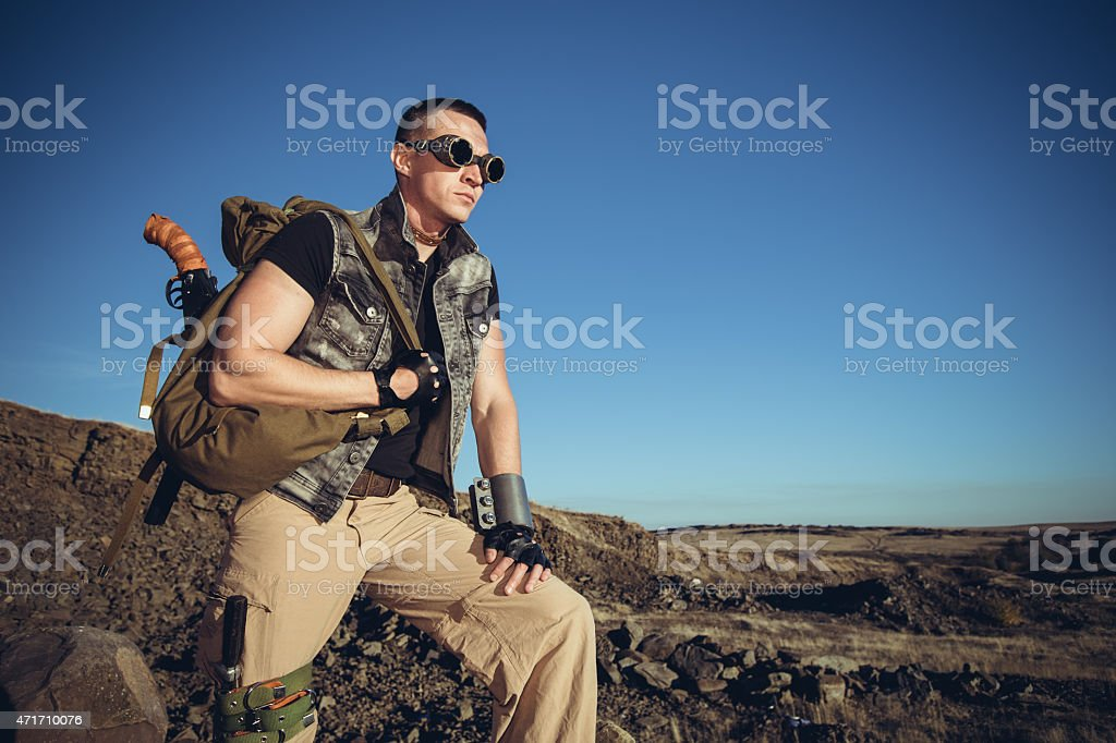 The handsome man in a fantastic suit of the soldier stock photo