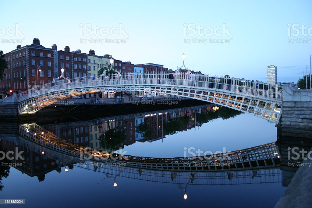 The Hapenny Bridge and its reflection in the water royalty-free stock photo