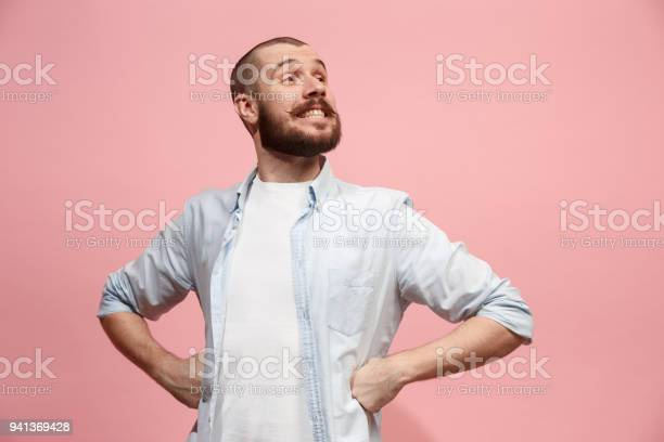 The happy business man standing and smiling against pastel background picture id941369428?b=1&k=6&m=941369428&s=612x612&h=nisilzx9vtv9gf2glfhks z qshr9qf4n7dnujcg na=