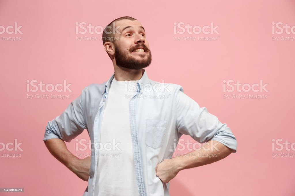 The happy business man standing and smiling against pastel background stock photo