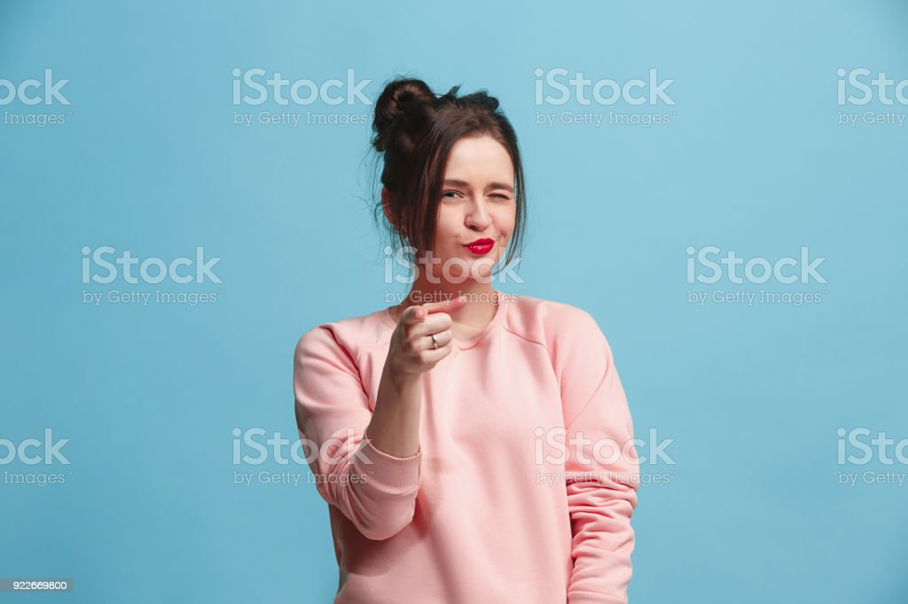 The happy business woman point you and want you, half length closeup portrait on blue background stock photo
