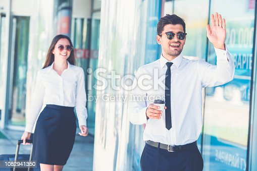 The happy businessman in sunglasses gesture near the woman