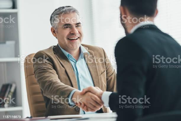 The happy businessmen handshaking near the desk picture id1137116573?b=1&k=6&m=1137116573&s=612x612&h=hwaq8tpwekkeq76gefgfopidldgjm0hinsmb2cufe8i=